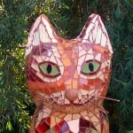 "Orange Tabby: Glass, mirror, shells, copper on styrofoam & concrete. 24""H x 9""W x 11""D"